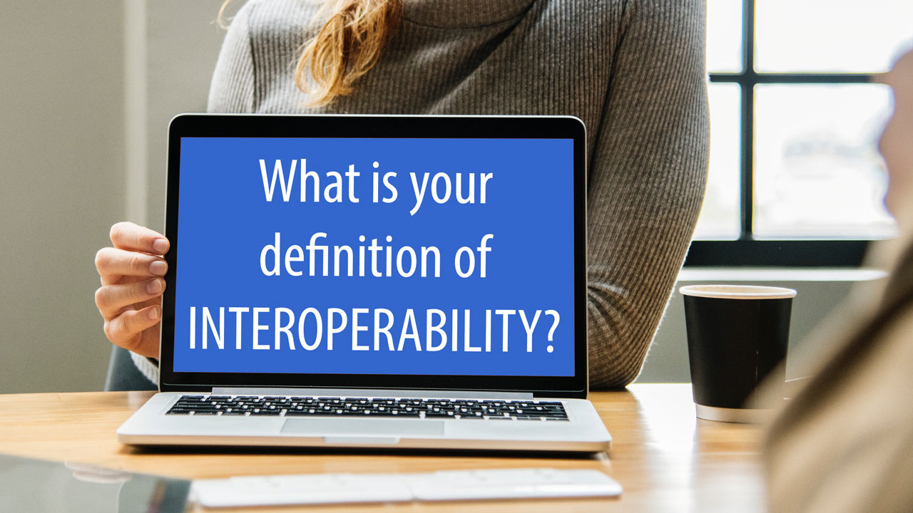Image of a laptop with the question 'What is your definition of INTEROPERABILITY?'.